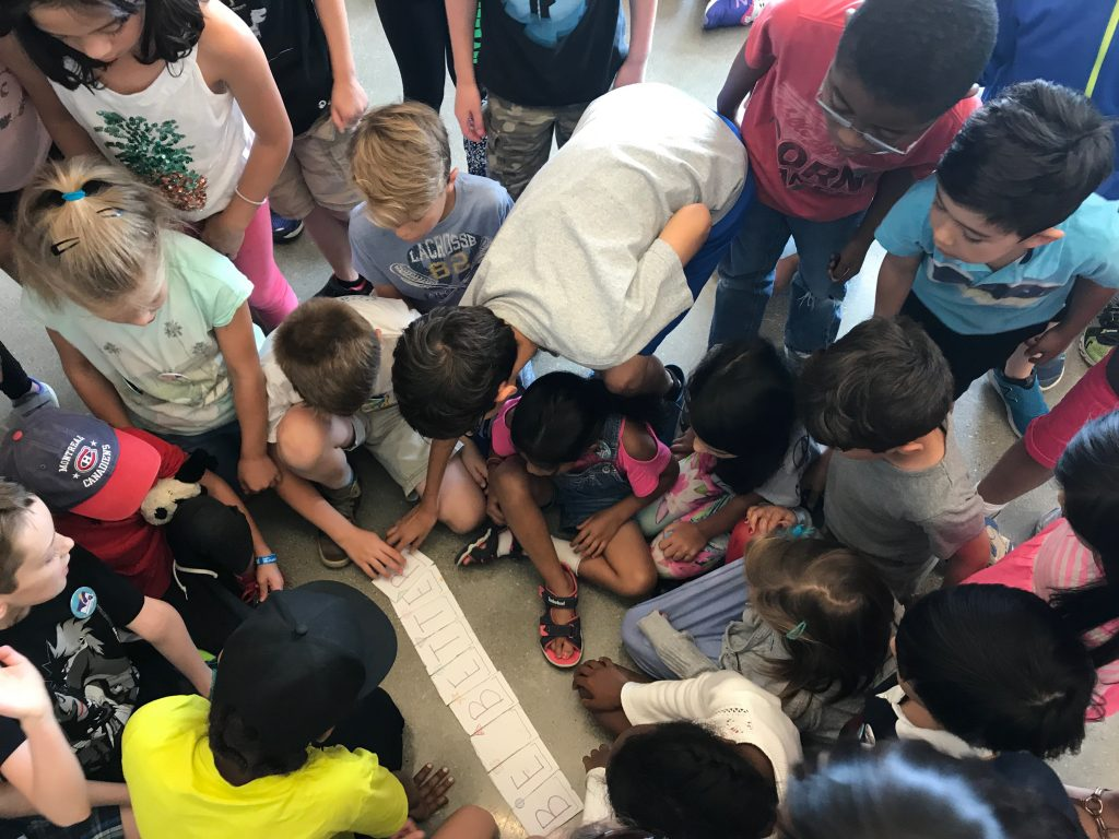 Campers using logic to solve fun puzzles