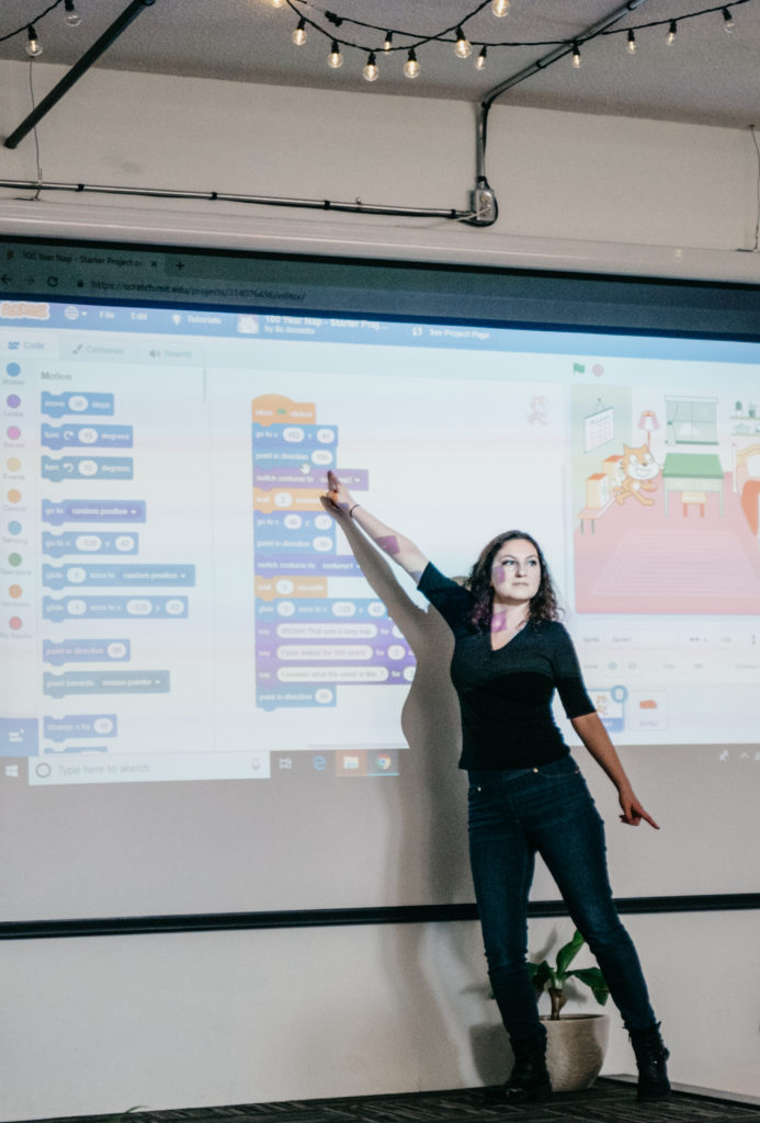Instructor showing the piece of code on the projector screen