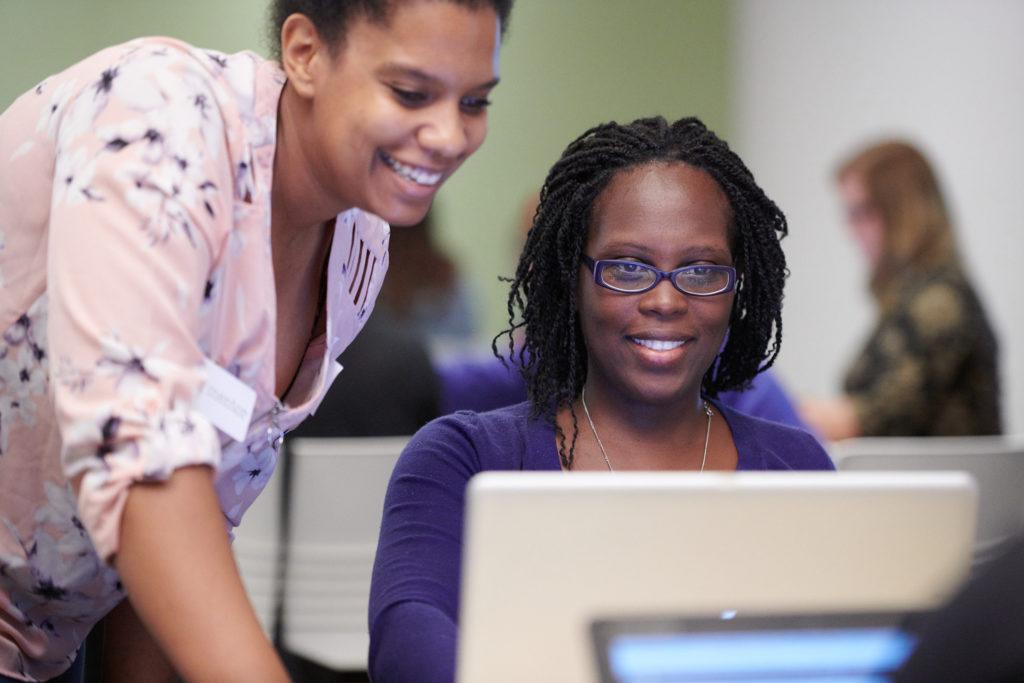 women learning code in classroom