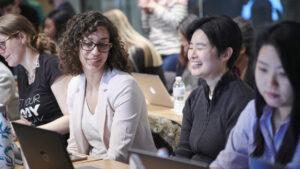Women laughing in LLC workshop