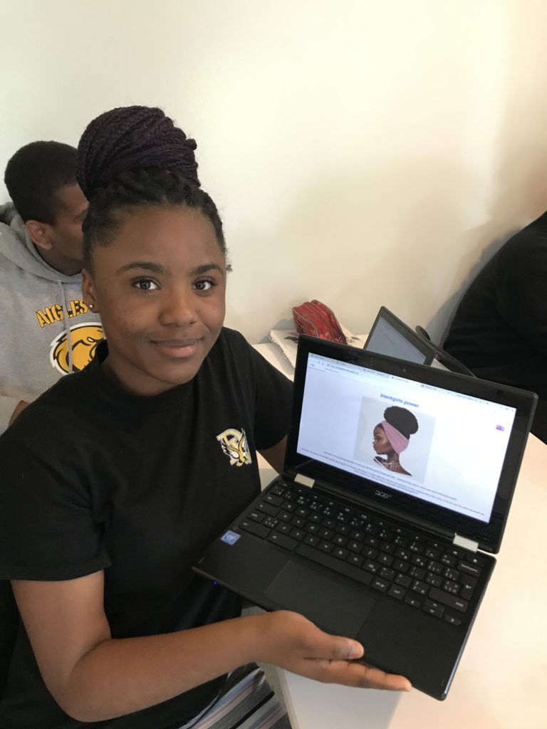 girl presenting project on laptop