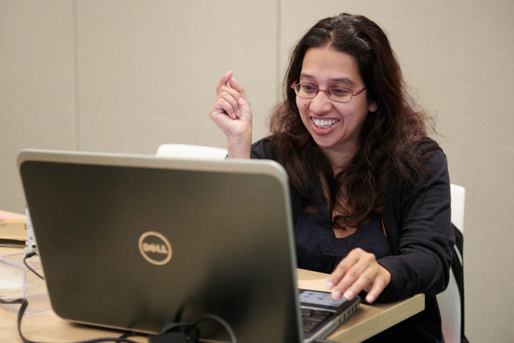 Educator smiling on laptop