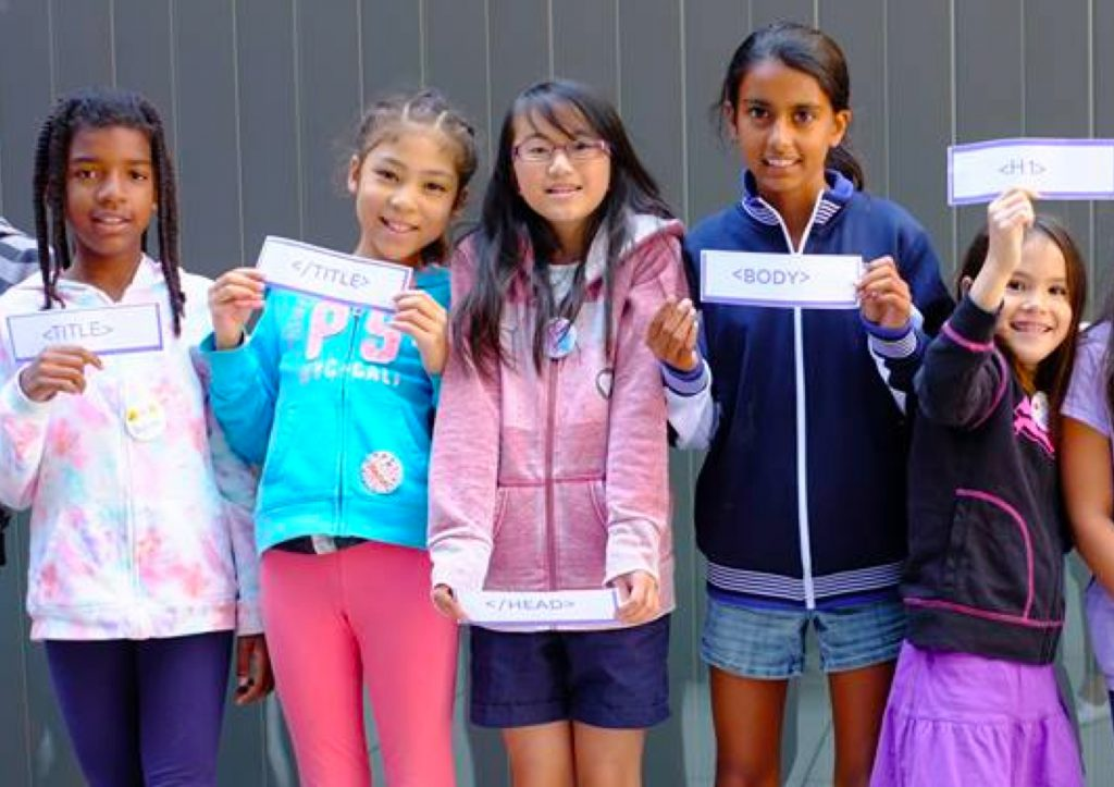 picture of girls holding up code