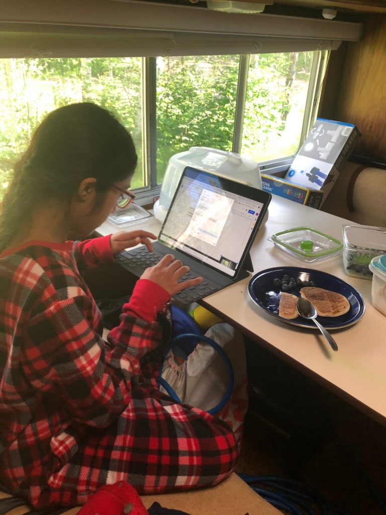 Girl typing on her laptop