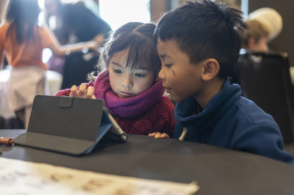 Two kids on a tablet
